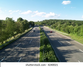 autobahn, highway landscape - cars on  highway, clouds and the blue sky