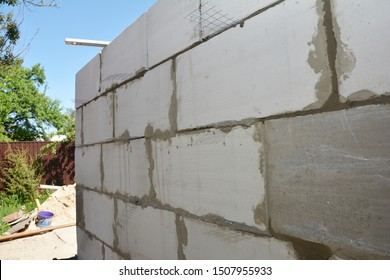 Autoclaved Aerated Concrete Blocks, AAC House Construction. Laying autoclaved aerated concrete blocks, aac for house construction wall concept