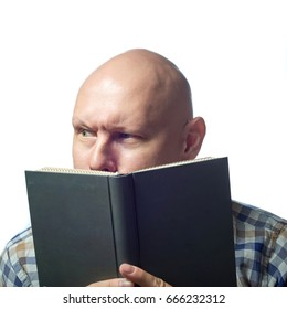 Autoimmune total alopecia men portrait. Absolute bald head with no eyebrows read the book