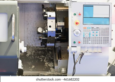 Automated CNC toolroom lathe with control console