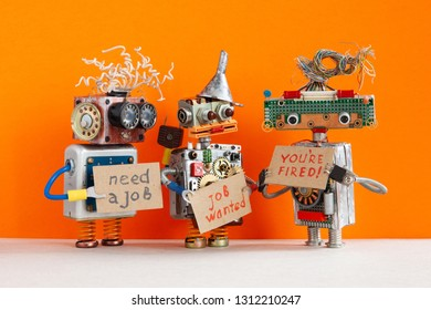 Automated dismissal and hiring of staff. The relationship between employer and employee. robot boss dismisses personnel and shows cardboard You are fired. Two unemployed robots looking for a new job.
