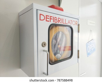 Automated Emergency Defibrillator on a box for emergency use. It is portable electronic device that automatically diagnoses the life-threatening cardiac arrest.