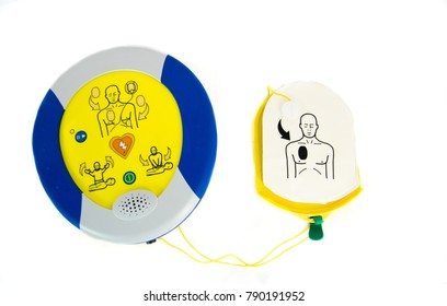An automated external defibrillator or AED with pads isolated on white.
