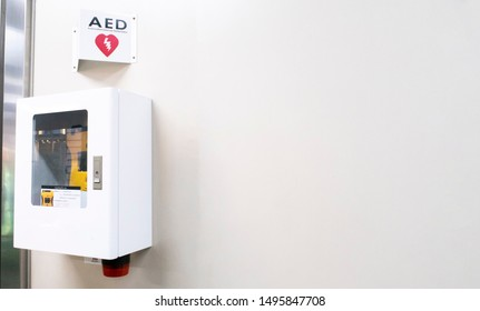 automated external defibrillator in emergency box with symbol AED on white background