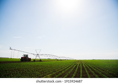 Automated farming irrigation sprinklers system on cultivated agricultural landscape field