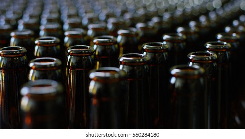 Automated industrial chain of bottles for beer and alcoholic and soft drinks. The concept of industry and sectors of automation and robots.