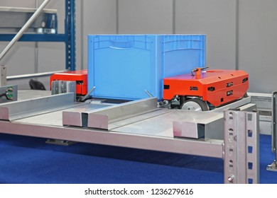 Automated Pallet Shuttle For Crat Transport at Shelves in Warehouse
