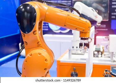 automated robot arm with control panel in production line of smart factory,