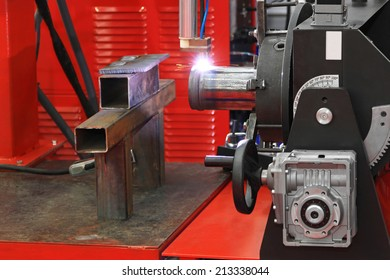 Automated robot welding gas pipe in workshop