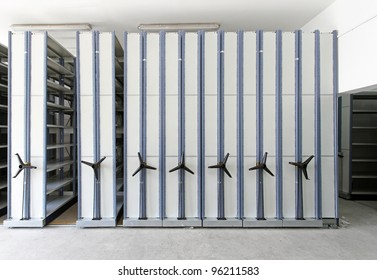 Automated shelving system with mobile cabinet for documents