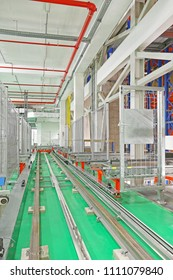 Automated Storage and Retrieval System Rails in Distribution Warehouse