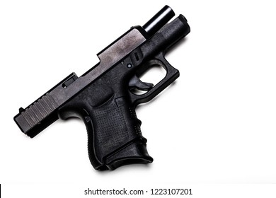 Automatic 9mm pistol with the bolt open isolated on a white background