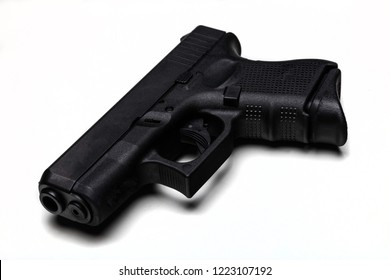 Automatic 9mm pistol isolated on a white background