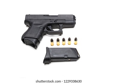 Automatic 9mm pistol isolated on a white background with bullets