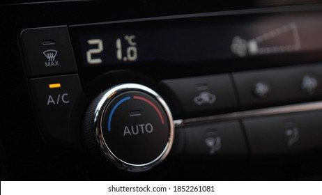 automatic air conditioner in the car. Air conditioner ring. Display indicates temperature inside the car. Cooling air in the car