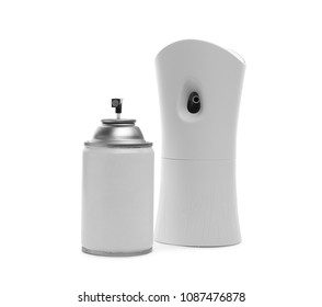 Automatic air freshener and aerosol bottle on white background