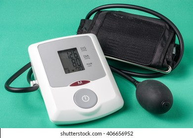 automatic blood pressure monitor on a green background