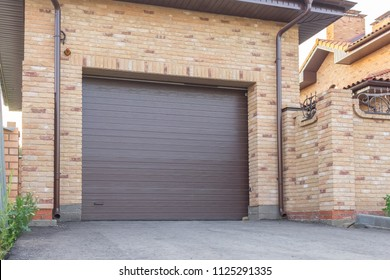 Automatic brown gate in the garage of a private house