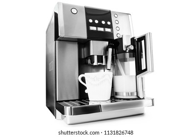automatic coffee maker with cup of coffee and milk jug on a white background