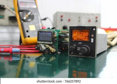 Automatic Direction Finder (ADF) control unit with maintenance ,Navigation system ,Avionics equipment.