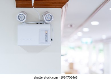 Automatic EMERGENCY LIGHT in hospital is charging and power pluging on the wall that ready to use when the power went out.