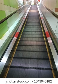 Automatic escalator in the supermarket
