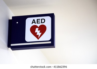 Automatic External Defibrillator AED Sign on a wall at an airport.