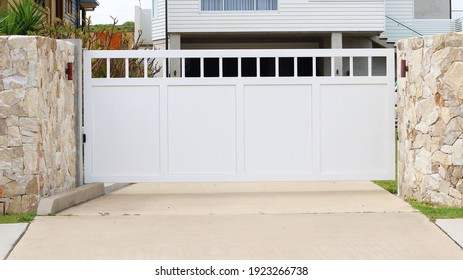 Automatic front gate with stone either side