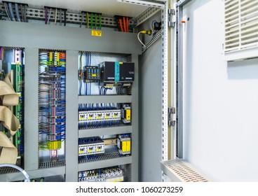 Automatic fuse electrical connector in power lines. Industrial electric enclosure, switch control panel board.