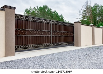 Automatic gates with a forged decor in a private house