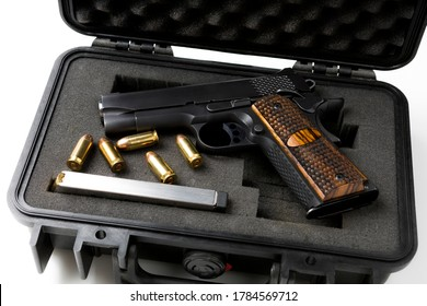 Automatic gun and bullets in a plastic hard case on white background
