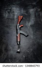 automatic gun on black background