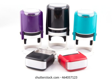 Automatic hand-stamps different colors on white background