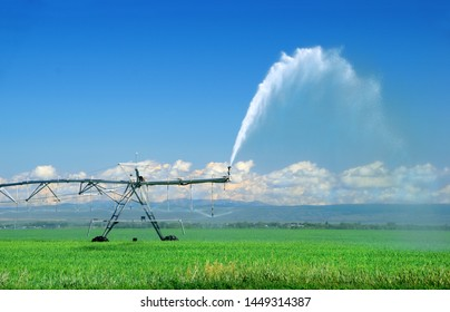 Automatic industrial irrigation equipment in action on a large farm field in Idaho, USA