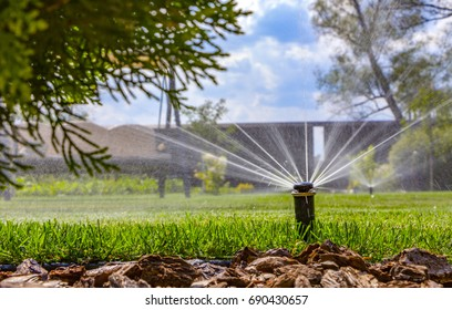 Automatic irrigation system on the background of green grass.