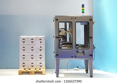 Automatic Labelling Machine and Boxes at Pallet