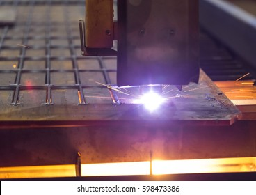 Automatic machine cuts the laser beam the steel. So make workpiece at an engineering plant.