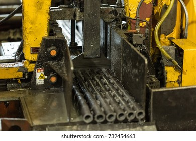 Automatic machine cuts pipe into Blanks steel round parts - bushings, rollers, rollers. All the details are the same.