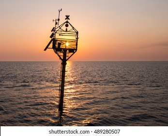 Automatic oceanographic maritime platform in the gulf of Trieste (Adriatic sea, Italy) at sunset. It is used for scientific research, ecological monitoring and weather and climate observations.