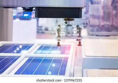 automatic production of solar panels, Industrial robotic pneumatic piston sucker unit on Conveyor.