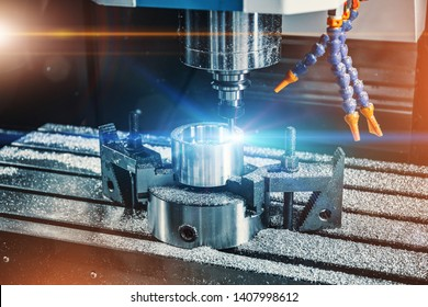 Automatic programmable CNC machine tool for grinding and cutting iron, metal work equipment, close up with light effects