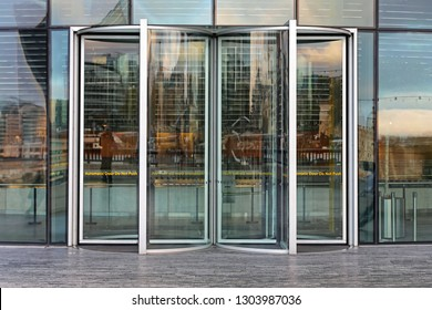 Automatic Revolving Door at Glass Office Building
