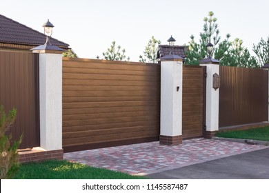 Automatic sliding sliding gates made of wood in a cottage