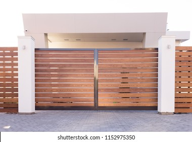 Automatic sliding gates made of wood in a private house