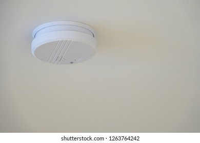 Automatic smoke detector fire alarm in the ceiling.
