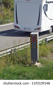 Automatic speed control radar on a French road with a motorhome passing by