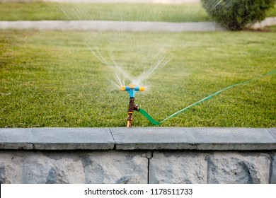 Automatic spinning sprinkler working in park