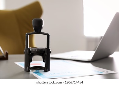 Automatic stamp and documents on desk in notary's office with space for text