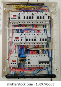 Automatic switches with wires in electrical shield close up. Electrical shield with automatic switches of electricity in the house - electricity control panel with circuit.