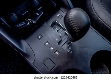 Automatic transmission gear, car interior. Automatic gear stick of a modern car, interior details, close up. Car detailing. Automatic transmission lever shift.